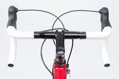Bicycle Concept. Partial View of Professional Carbon Road Bike. Handlebars With White Grip Tape. Against White. Horizontal Image royalty free stock photo