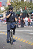 Bicycle Cop doing Crowd Control Royalty Free Stock Photography