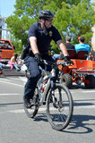 Bicycle Cop Stock Images