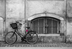 Bicycle. Copenhagen, Denmark - May,2017: Bicycle at the wall with window in black and white, selective color on a lock Stock Images