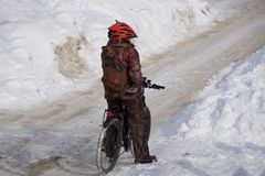 Bicycle courier in winter snow storm . stock photo