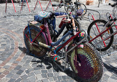 Bicycle covered with  colorful knitting Royalty Free Stock Photography