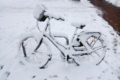 Bicycle covered in snow Stock Photography