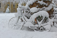 Bicycle covered with snow Royalty Free Stock Photography