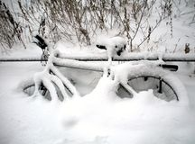 Bicycle covered with snow Stock Images