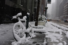 Bicycle covered in snow during winter storm Niko Manhattan, New York City Stock Photos