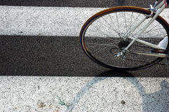 Bicycle on a cross walk. Detail of a bicycle on a cross walk Royalty Free Stock Images