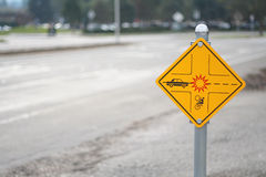 Bicycle crossing sign and road Royalty Free Stock Photography