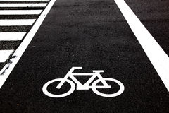Bicycle crossing. Symbol on the road Stock Photos