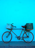 Bicycle in Cuba. Bicycle leaning against a bright blue wall in Varadero, Cuba stock photos