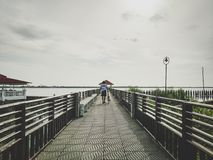 37 - Bicycle Cycling and Men on the big bridge royalty free stock image