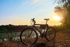 A bicycle at dawn near the pond. outdoor exercise Stock Photos