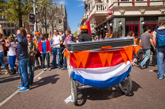Bicycle decorated with Dutch flag for Queen's day Royalty Free Stock Image