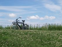 Bicycle on dike Royalty Free Stock Photo