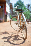 Bicycle on dirt street in home. Bicycle on dirt street, cycling in summer nature, vintage old retro bike, cycling Stock Photography