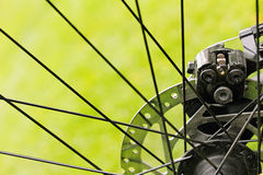 Bicycle disc brakes on green grass background Royalty Free Stock Photos