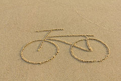 A bicycle drawing on the sand Royalty Free Stock Photo