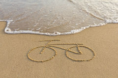 A bicycle drawing on the sand Stock Photography