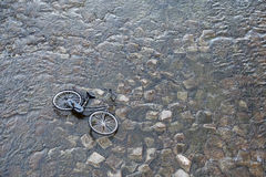 Bicycle dumped in the river, Kyoto Japan stock image