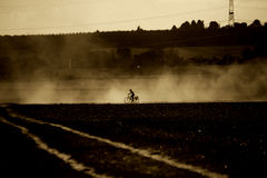 Bicycle in the dust Royalty Free Stock Photos