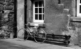Bicycle in Edinburgh close. Bicycle in an Edinburgh close courtyard Royalty Free Stock Photos