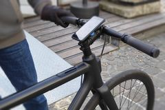 Bicycle electric and smart phone nowaday. Background of one man ride bicycle electric and use mobile phone to guide a destination, kilometer, and energy stock images