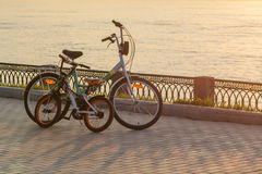 Bicycle on the embankment of the river Volga. Bicycle on the embankment of the Volga river at sunset Royalty Free Stock Photo