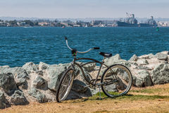 Bicycle at Embarcadero Park South in San Diego. California, with view of Coronado and military vessels in background stock image