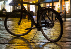 Bicycle with evening city lights Stock Images