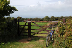 Bicycle by farm gate on Sark Stock Image