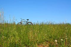 Bicycle on field Royalty Free Stock Photos