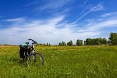 Bicycle among a fields. Bicycle among a green hills stock photography