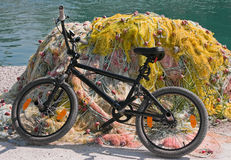 Bicycle and fishing gear. Royalty Free Stock Images