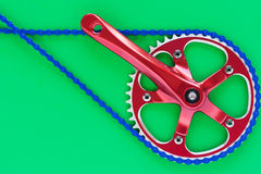 Bicycle fixie crank. Red single speed crank from a hipster bike Stock Images