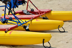 Bicycle floater on sand. Bicycle floater arrange on sand, shown as marine sport and entertainment or enjoy Royalty Free Stock Photo
