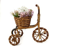 Bicycle With Flowers. Bicycle of wood loaded with wild flowers Stock Photography