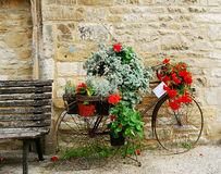 Bicycle with flowers displayed in Cotswolds Royalty Free Stock Image