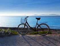 Bicycle in formentera beach with Ibiza sunset Stock Photography