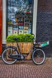 Bicycle in front of a boutique in Amsterdam royalty free stock photography