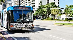 Bicycle on front bumper bus florida state usa Stock Images