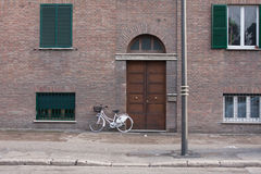 A bicycle in front of a door in terni, italy. Front door of italian house in rite Royalty Free Stock Images