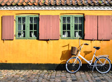 Bicycle in front of the entrance to an apartment in one of the h Royalty Free Stock Images