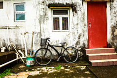 Bicycle in front of a house Royalty Free Stock Photography