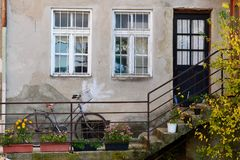 Bicycle in front of the house. Parked one bicycle in front of the house Royalty Free Stock Images