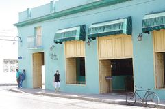 Corner cafe shop in Cuba. Bicycle in front of La Perla De Cuba, a corner cafe shop in Camaguey, Cuba stock photography
