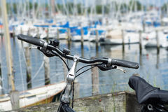 Bicycle in front of the marina with blurred yachts Stock Image