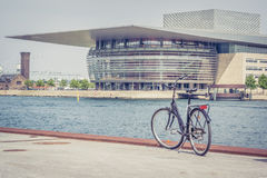 Bicycle in front ofthe  Royal Opera House in Copenhagen. Bicycle in front of the Copenhagen Opera House on the island of Holmen in central Copenhagen. June 15 Royalty Free Stock Photo