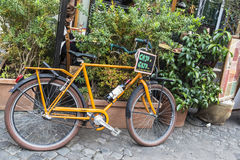 Bicycle in front of a restaurant bar in Rome, Italy Stock Image