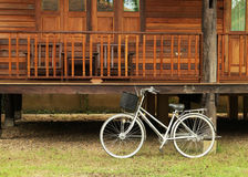 Bicycle in front of Teak Wood House Royalty Free Stock Photos