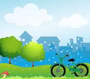 A bicycle in front of the village Royalty Free Stock Image
